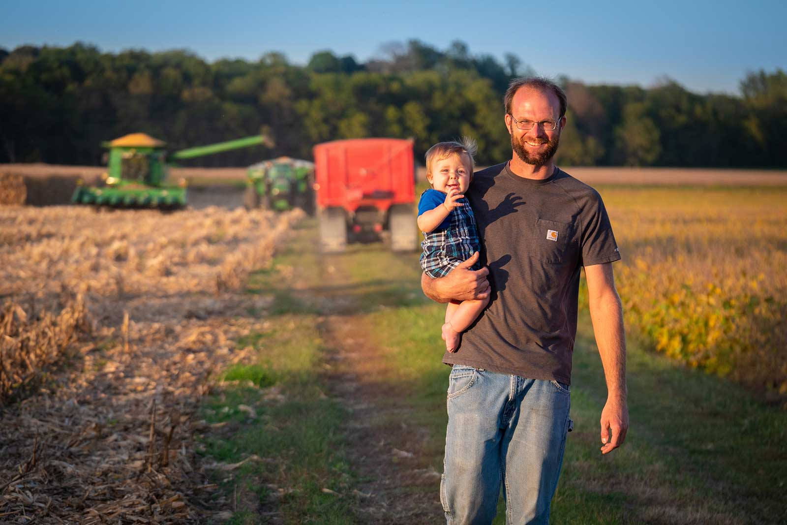 Photo of farmer and son